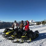 group of three riders snowmobiling in montana