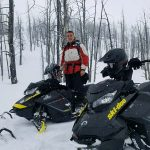 two snowmobilers trail riding in montana
