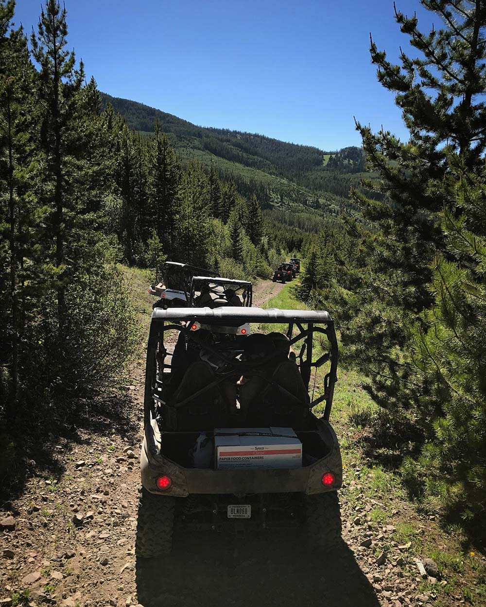 side by side trail riding in montana through forest